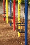 Three empty teeter with chains royalty free stock photos
