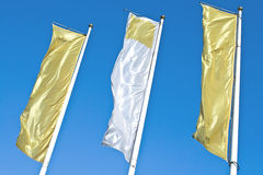Three empty vertical banner golden flags Stock Images