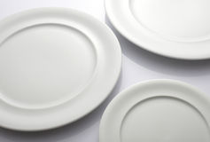 Three Empty white plates Royalty Free Stock Photos