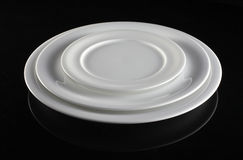Three Empty white plates Stock Image