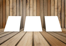 Three empty white poster frame put on old grunge texture wooden interior room for present product, perspective wooden floor Stock Photos