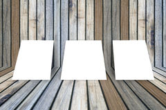 Three empty white poster frame put on old grunge texture wooden interior room for present product, perspective wooden floor Royalty Free Stock Photography