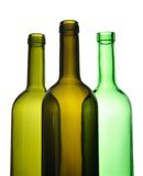 Three empty wine bottles for recycling Stock Photography