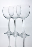 Three empty wine glasses with reflections Stock Images