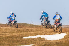 Three enduro racers. Enduro racers with mud on motorbike Stock Photo