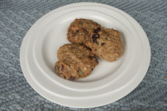 Three energy cookies on a plate. Healthy freshly baked homemade oatmeal cookies on a plate Royalty Free Stock Photos