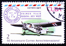 Three-engine plane and Cuba-Key West 1st flight cancel, Oct. 28, 1927. MOSCOW, RUSSIA - FEBRUARY 12, 2017: A stamp printed in Cuba shows Three-engine plane and Royalty Free Stock Photos