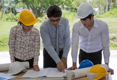 Three Engineer Teams I& x27;m talking about construction. Architect team working on project. Cooperation, teamwork, design, planning concept Stock Photos