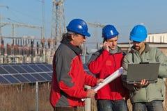 Three Engineers at Work Royalty Free Stock Photos