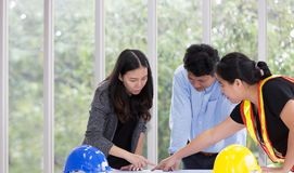 Three engineers working meeting room at the office. Three worker royalty free stock photography
