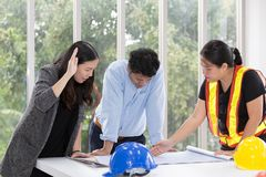 Three engineers working meeting room at the office. Three worker stock images