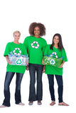 Three enivromental activists with two holding boxes of recyclabl Royalty Free Stock Photos