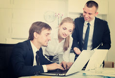 Three enthusiastic coworkers different sexes working in company Royalty Free Stock Image