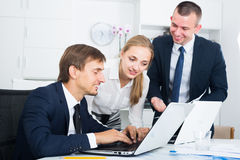 Three enthusiastic coworkers different sexes working in company Royalty Free Stock Images