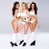 Three enticing female football players Stock Image