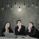 Three entrepreneurs find the solution Royalty Free Stock Photo