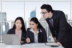 Three entrepreneurs planning a job in office Stock Photography