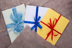 Three envelope sacking tied with ribbon. Red blue Royalty Free Stock Images