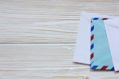 envelopes on wooden background Royalty Free Stock Image