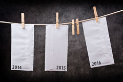 Three Envelopes with year numbers on clothes rope Royalty Free Stock Images