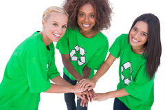 Three enviromental activists putting their hands together and sm Stock Photos