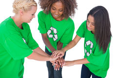 Three enviromental activists putting their hands together Royalty Free Stock Image