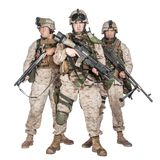 Three equipped and armed U.S. marines studio shoot stock images