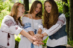 Three Ethno Beauty teens having fun. Happy Teenagers. Three Teenagers Happy smiling with background of green trees Royalty Free Stock Photo