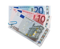Three euro banknotes held together clip Stock Image