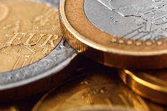 Three euro coins Stock Images