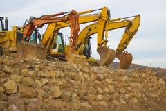 Three excavators Stock Photos