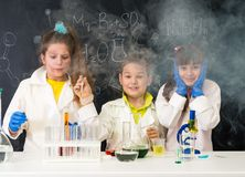 Three excited children after chemical experiment Stock Image
