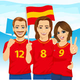 Three excited Spanish soccer fans in stadium Stock Photography