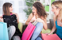 Three excited young girls after shopping at home Royalty Free Stock Photo