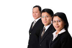 Three executives. One businesswoman along the two businessman, focusing on the woman royalty free stock images