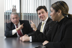 Three executives in discussion. Royalty Free Stock Image