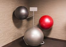 Three exercise balance balls on a rack stock photography