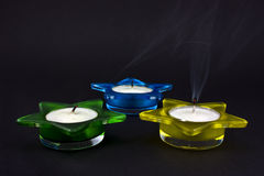 Three extinguished candles stock photos