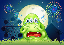 A three-eyed monster crying at the carnival Stock Photo