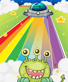 A three-eyed monster near a spaceship Stock Photo