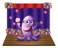 A three-eyed purple monster at the center of the stage Stock Images