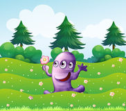 A  three-eyed violet monster above the hill Stock Image