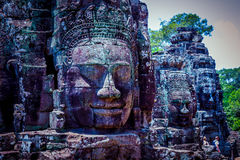 Three face. Faces carved on rocks one after the other royalty free stock photos