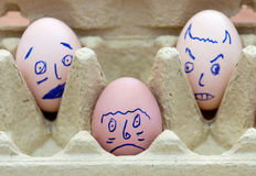 Three face painted eggs Royalty Free Stock Photo