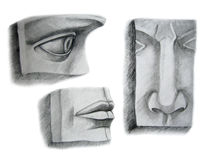 Three face parts. Pencil drawing of the three face parts, eye, nose and lips, made from plaster Royalty Free Stock Photo