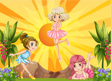 Three fairies flying in the garden Royalty Free Stock Image