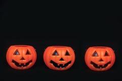 Three fake pumpkins in a row Stock Photos