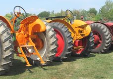 Three farm tractors from a rear view Stock Images