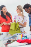 Three fashion designers holding textile Stock Photo