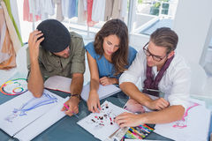 Three fashion designers working together Stock Photo